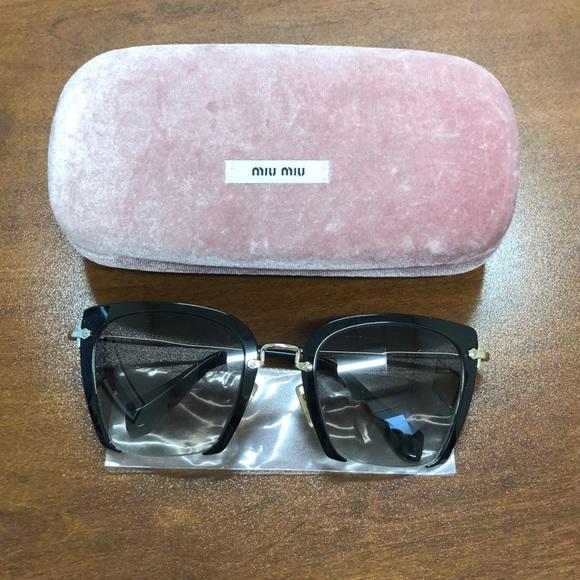 7dc35a5cf7a Miu Miu Cut Frame Sunglasses. M 5c3df340a31c3322baeaf58b